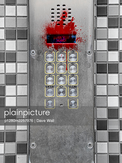 Intercom system covered in blood - p1280m2257976 by Dave Wall