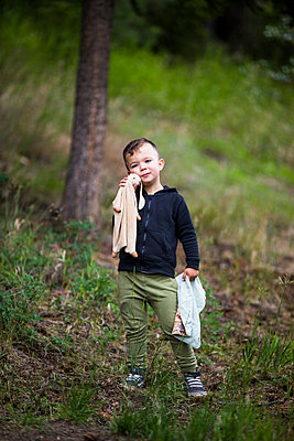 Portrait of toddler boy holding bunny and his small blanket. - p1166m2147356 by Cavan Images
