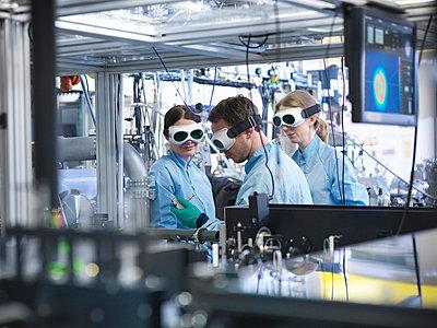 Scientists working together in lab - p429m662322f by Monty Rakusen