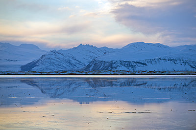 Mountains reflected in still ocean in arctic landscape - p555m1415688 by Pete Saloutos