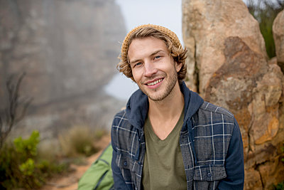 Young man on a hiking trip high in the mountains - p1355m1574135 by Tomasrodriguez