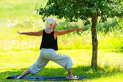 Woman training yoga - p1418m2193314 by Jan Håkan Dahlström