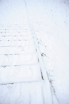 Steps covered with snow Sweden - p5281646f by Cecilia Enholm