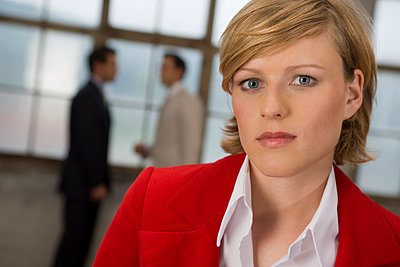 portrait of businesswoman in red jacket - p3161827f by Emana