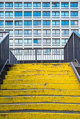 Yellow steps in a city centre - p1302m1584120 by Richard Nixon