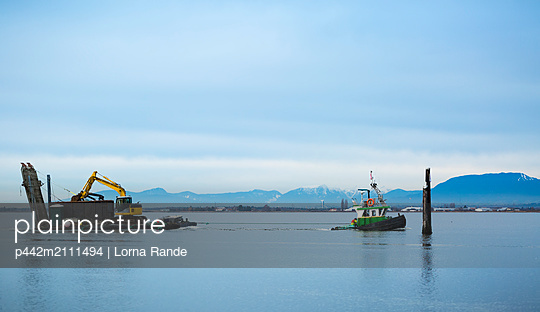Tugboat pulling barge with construction equipment, Blackie Spit, Crescent Beach; Surrey, British Columbia, Canada - p442m2111494 by Lorna Rande