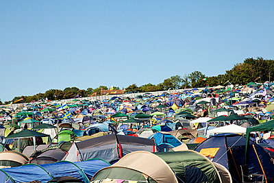 Tents at summer music festival - p9243445f by Image Source