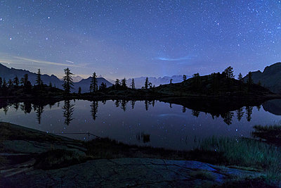 Starry night on Mount Rosa seen from Lake Vallette, Natural Park of Mont Avic, Aosta Valley, Graian Alps, Italy, Europe - p871m1056725 by Roberto Moiola