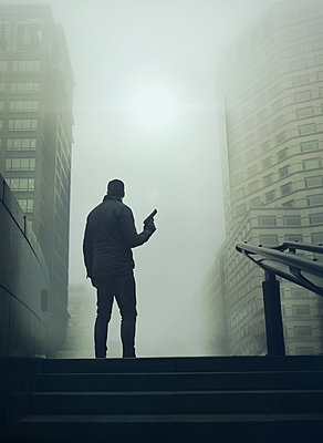 Man with gun - p984m1222330 by Mark Owen
