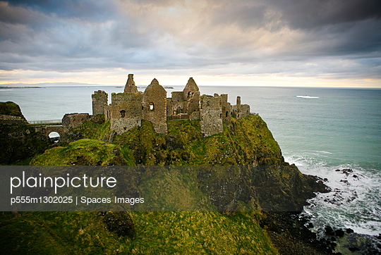 Castle ruins on cliff at ocean