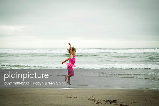 Female toddler jumping on beach - p924m884298f by Robyn Breen Shinn