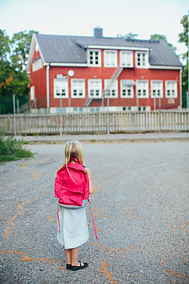 Girl with backpack - p312m1229163 by Anna Rostrom