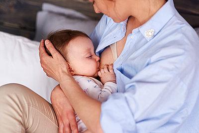 Mother breastfeeding her baby - p300m1581266 by gpointstudio