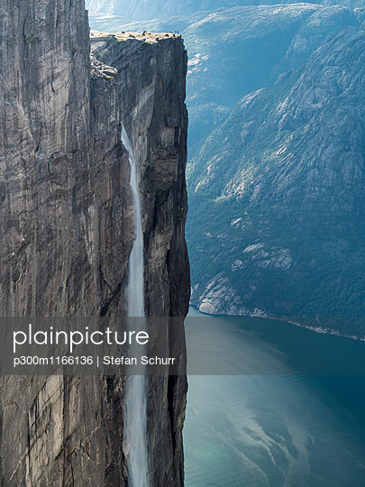 Norway, Forsand, Kjerag rocky plateau, waterfall and view to Lyse fjord - p300m1166136 by Stefan Schurr