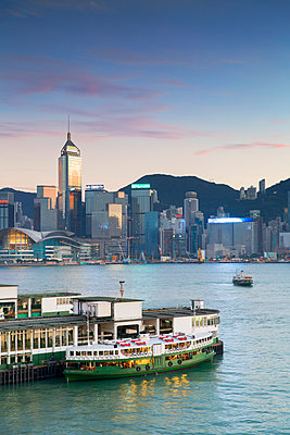 View of Star Ferry Terminal and Hong Kong Island skyline, Hong Kong, China - p651m2006451 by Ian Trower