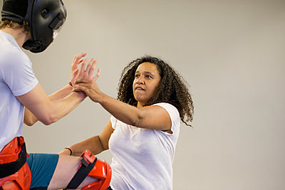 Young woman training self defense - p445m1503889 by Marie Docher