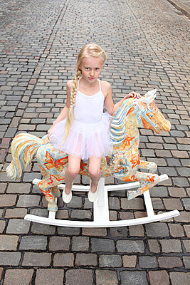 Girl on her rocking horse - p045m853386 by Jasmin Sander