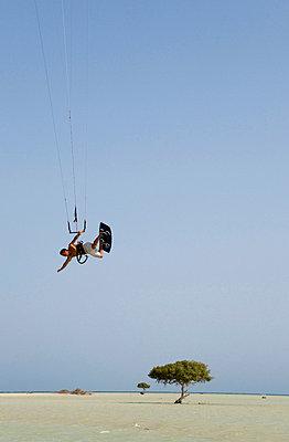Egypt, Kitesurfer in midair - p3008363f by Gerald Nowak