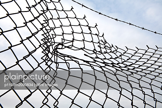 Hole in Chain Link Fence - p1100m2090834 by Mint Images