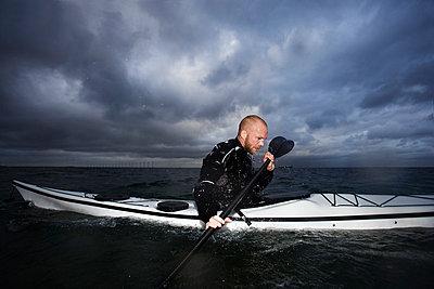 Man in kayak - p42913682f by Soren Hald