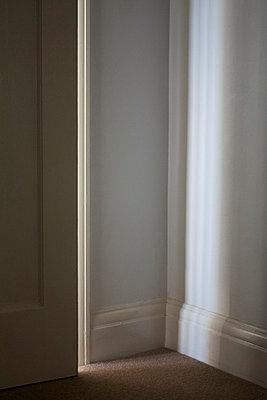 Light cast through door ajar - p1121m1132515 by Gail Symes