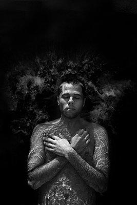 Man Floating in Dark Water - p1262m1110481 by Maryanne Gobble