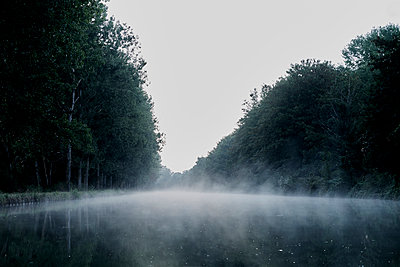 River with fog at dusk - p1312m2258022 by Axel Killian