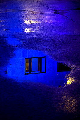 Reflection of a window on a puddle, Sweden - p348m732974 by Andreas Molin