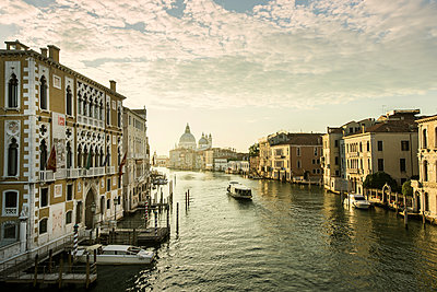 Italy, Venice, Canal in city at sunrise - p352m1127277f by Mickael Tannus