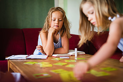 Girls playing together - p312m2080252 by Anna Johnsson