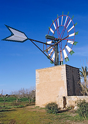 Wind mill on a farm - p8850172 by Oliver Brenneisen