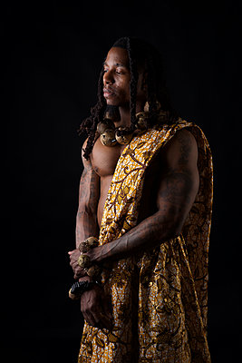 African man in traditional african garment  - p1554m2223485 by Tina Gutierrez