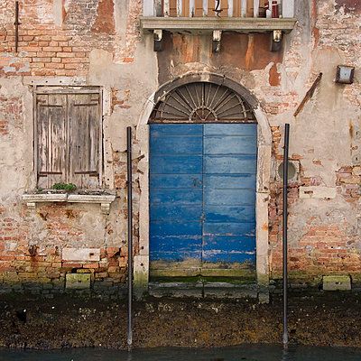 Canalside door, Venice building exterior. - p8552313 by Mike Burton