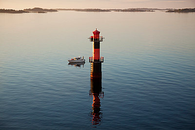 High angle view of lighthouse and sailing boat - p528m713850 by Kenneth Hellman