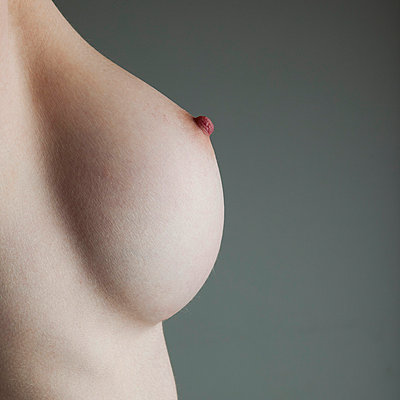 Woman's breast close-up - p4130734 by Tuomas Marttila