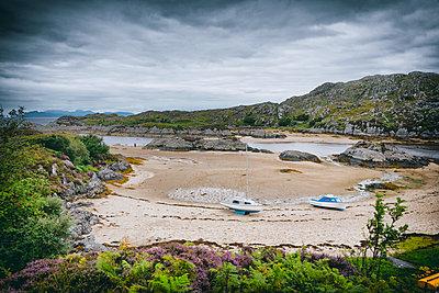 Cove bay sand beach idyllic islands low tide cliff - p609m1192640 by OSKARQ