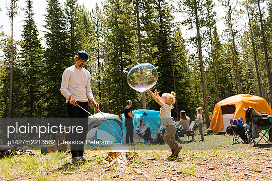 Girl (6-7) playing large soap bubble on camping, Wasatch-Cache National Forest - p1427m2213562 by Jessica Peterson
