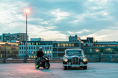 Motorbiker alongside Mercedes Benz Ponton  - p1437m2254425 by Achim Bunz