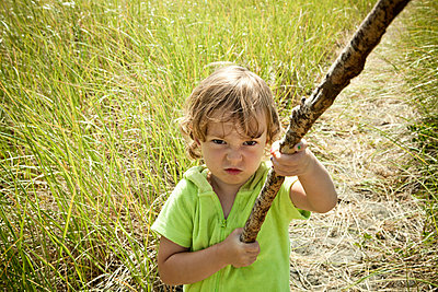Portrait of female toddler holding long stick - p924m884302f by Robyn Breen Shinn
