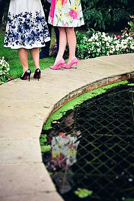 Two Women by pond - p1072m2160767 by Neville Mountford-Hoare
