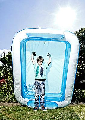 Boy with paddling pool - p1221m1041708 by Frank Lothar Lange