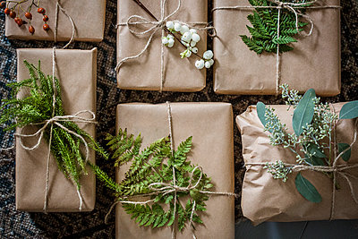 Sweden, Wrapped Christmas presents with twigs - p352m1100117f by Lina Östling