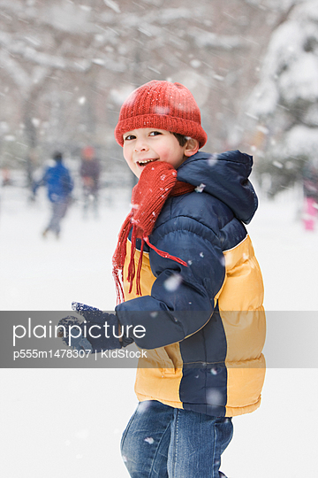 Smiling boy playing in snow
