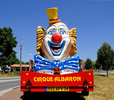 Large clown advertising traveling circus - p1072m829446 by Neville Mountford-Hoare