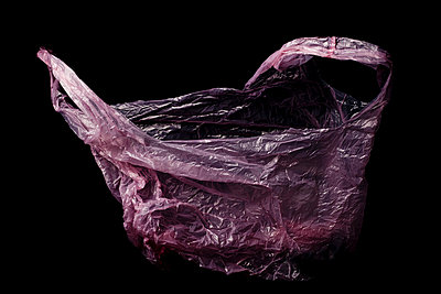 Red plastic bag - p4451012 by Marie Docher
