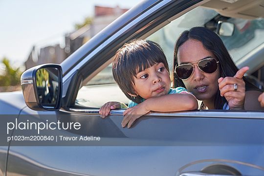 Mother and son looking out sunny car window - p1023m2200840 by Trevor Adeline