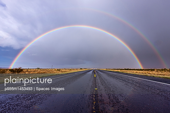 Rainbow on a Rural Road - p555m1453493 by Spaces Images