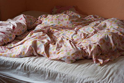Crumpled up child's bed covers - p1072m829524 by Tracy Jean Shields