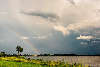 Germany, Ruegen, Middelhagen, Moenchgut, rainbow above the water - p300m2005485 by Jana Mänz