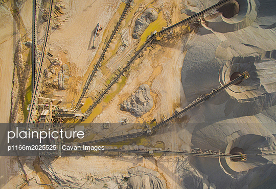 Aerial view of factory on land - p1166m2025525 by Cavan Images